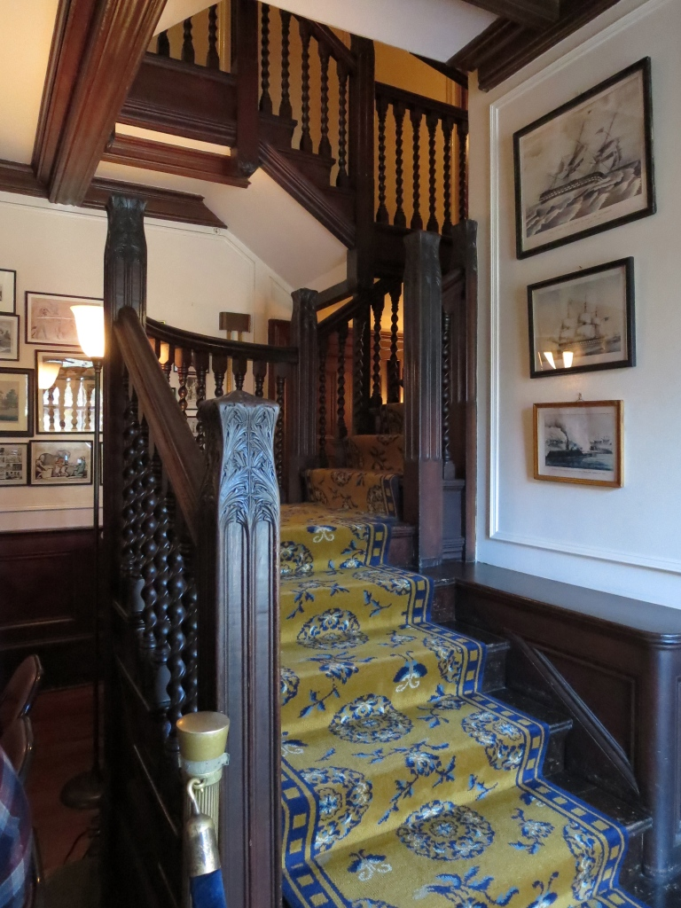 The main staircase featured such a beautiful banister; the woodwork throughout the home, while on the heavy/dark side, really lent an air of richness.